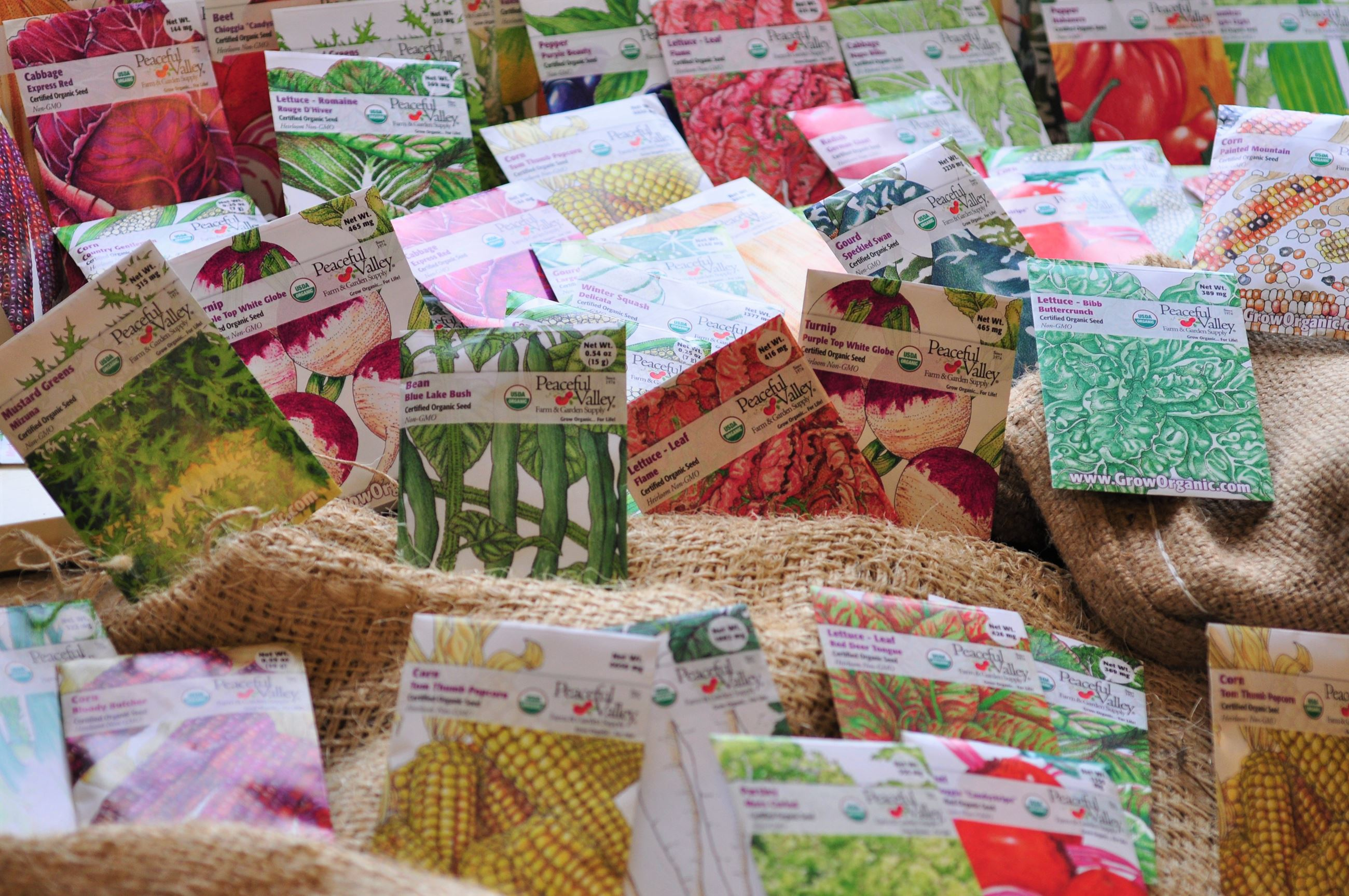 Seed packets on a burlap bag