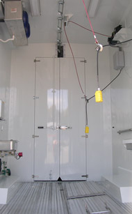 A mean storage container with wires hanging from the ceiling